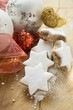 Cinnamon stars surrounded by Christmas decorations