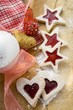 Heart- and star-shaped jam biscuits