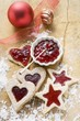 Star- and heart-shaped biscuits with raspberry jam