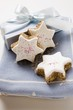 Cinnamon stars in front of Christmas gift