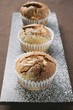 Three chocolate and vanilla muffins in paper cases