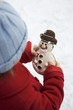 Child holding snowman biscuit