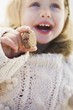 Small girl holding a Christmas biscuit