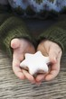 Child's hands holding cinnamon star