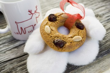 Gingerbread tree ornament, fur mittens and cup