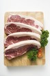 Sirloin steaks on chopping board