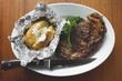 Grilled beef steak with baked potato