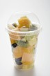 Fruit salad in a plastic beaker