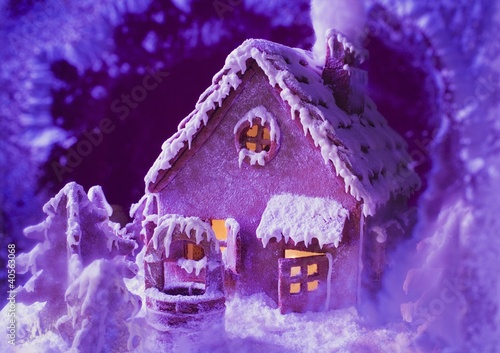 Gingerbread house in purple light