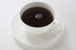 Black coffee in white cup and saucer