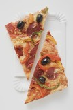 Slice of pepperoni pizza with peppers and olives (halved)