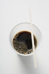Black coffee in plastic cup (overhead view)