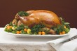 Stuffed roast turkey with kumquats and herbs