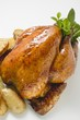 Whole roast chicken with herbs and potatoes
