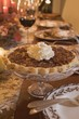 Pecan pie with cream on table laid for Thanksgiving (USA)