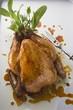 Roast chicken with fresh herbs (overhead view)