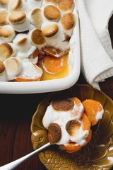 Sweet potato & marshmallow gratin in baking dish & on spoon