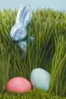 Easter Bunny and coloured eggs in grass