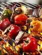 Meat and pepper kebabs on barbecue