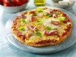 Pizza with ham and basil