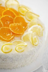 Orange and lemon gateau with grated coconut