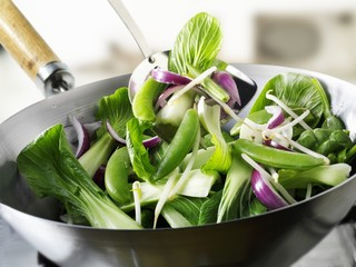 Green vegetables in wok
