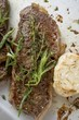 Beef steaks with herbs and garlic (overhead view)