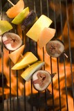 Fruit kebabs on barbecue grill rack