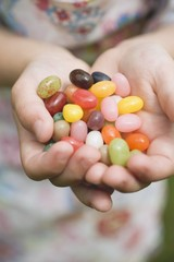 Child's hands holding coloured sugar eggs