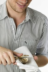 Man opening a fresh oyster