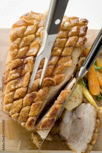 Roast belly pork with crackling and vegetables