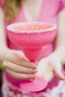 Woman holding a pink cocktail