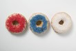 Three doughnuts with sprinkles (red, blue, white)
