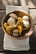 Chanterelles and ceps in wooden bowl