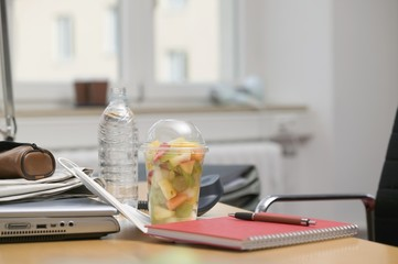 Fruit salad and bottle of water in office