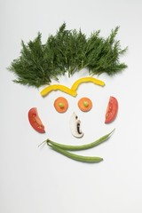 Amusing face made from vegetables, rosemary and mushroom