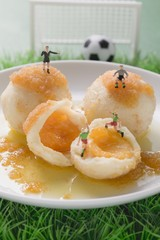 Apricot dumplings with football figures