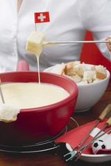 Woman eating cheese fondue