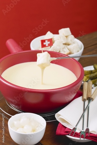 Cheese fondue with Swiss flag