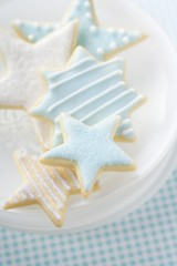 Star biscuits with blue and white icing on plate