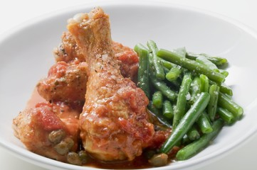 Chicken with tomato sauce, capers and green beans