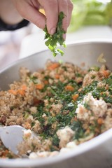 Sprinkling parsley into bread stuffing