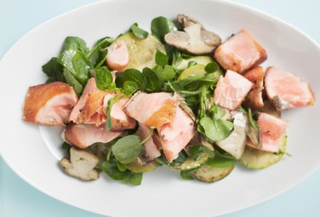 Salad leaves with fried salmon and mushrooms