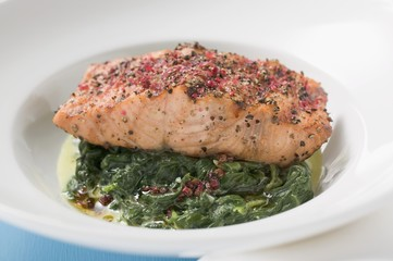 Spicy salmon fillet on spinach