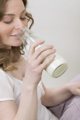 Woman drinking milk out of bottle
