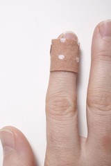 Finger with sticking plaster