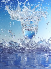 Blue water splashing out of glass
