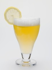 Glass of shandy with slice of lemon (UK)
