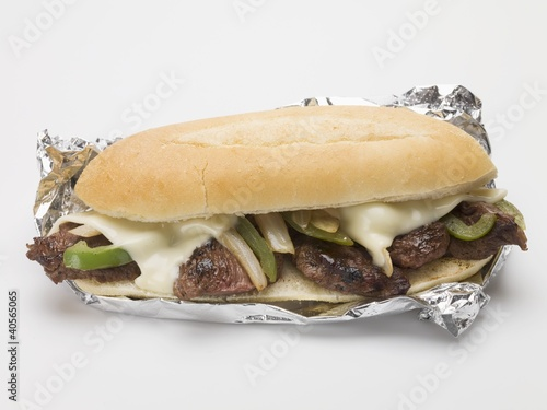 Beef, cheese, green pepper & onion sandwich in aluminium foil