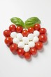 Tomato and mozzarella forming a heart with basil